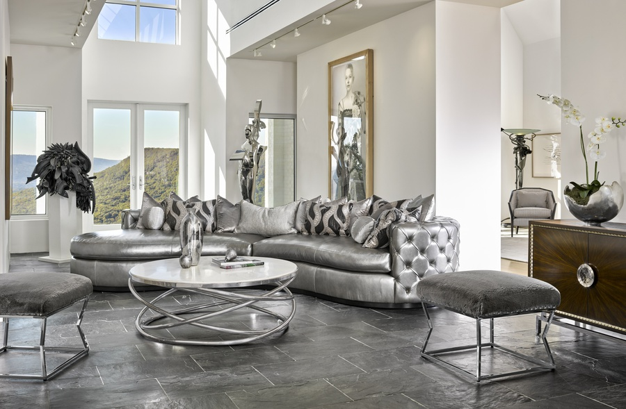Aurora2-Piece Sofa shown with:Boxed bench seatSilver button tufted inside and outside backBuilt-to-the-floor with wood plinth in Bombay finish