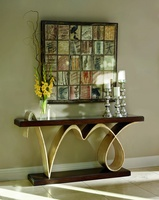 Bolero Console shown with:Contemporary Havana finish on platform and topMedici finish on sculptured base