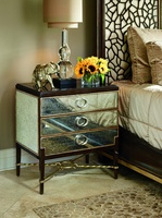 Bolero Nightstand shown with:Bombay finishBurnished Silver Leaf finish trimAntique Mirror drawers and side panel insetsDecorative metal stretcher in Specialty Leaf finishPolished Absolute Black Granite topPolished Nickel hardware