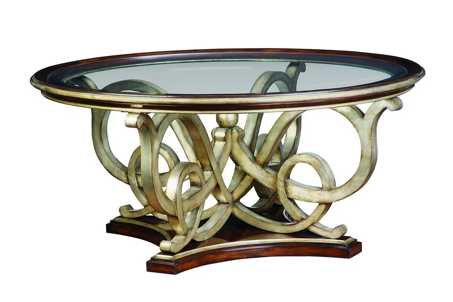 Bossa Nova Cocktail Table shown with:Contemporary Havanafinish Versailles Leaf finishtrimDecorative metalwork with ball detail in Versailles finish Clear inset glasswith beveled edge