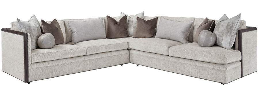 Burton Sectional shown with:BRT52 and BRT56Boxed seat cushionBuilt-to-the-floor baseTwilightfinishBlack Nickelnailhead frame trim Photographedwith Long Armoptionon the left side facing,Short Arm on the right side facing