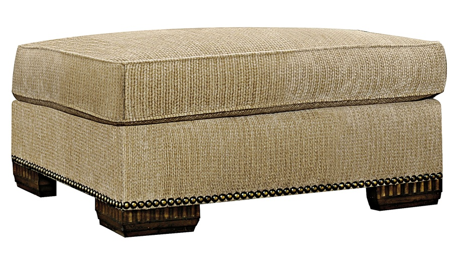 Bentley Ottoman shown with:Semi-attached boxed cushion with self pencil weltBuilt-to-the-floor with wood legs in Old World Briar finishAntique Brass nailhead frame trim