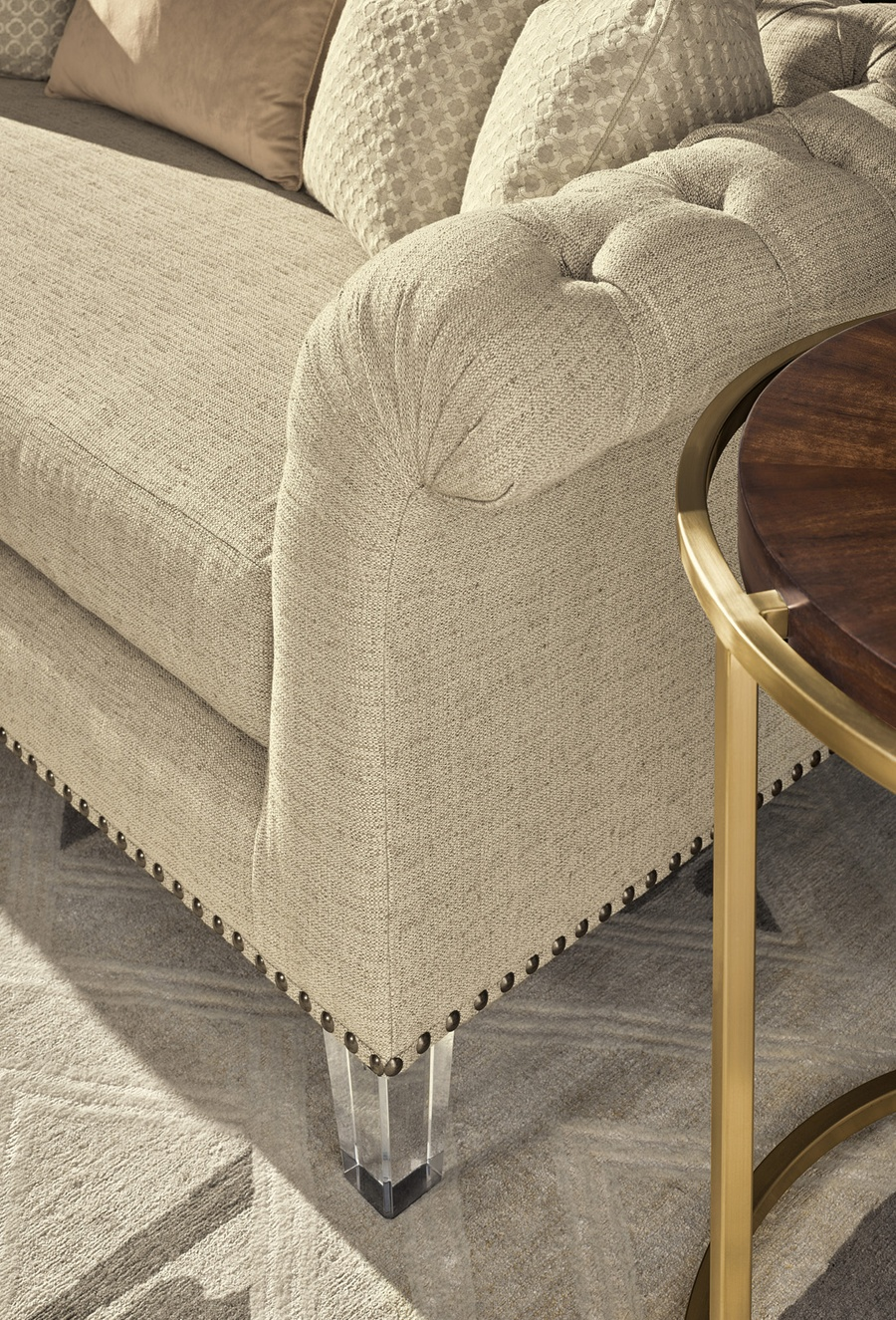 Frame Trim: Antique Brass NailheadShown with Exposed Wood Legs option in Aria finish