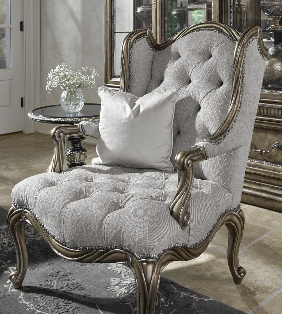 Coco Chair shown with:Tufted seat with Silver Star buttonsBronzed Silver finishVerona Silver Leaf finish trimSilver Star nailhead trim