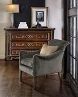 Chloe Chair shown with:Bronzed Silver finish on exposed wood legsGunmetal nailhead frame trim