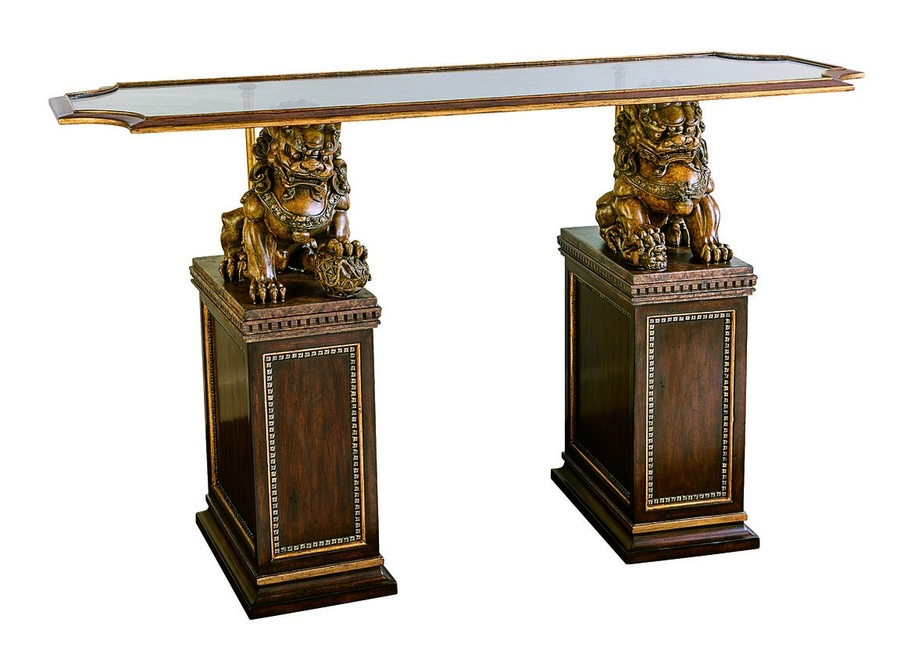 Cross Channel Console shown with:Havanafinish withAged Gold Leaftrim on basesAntique Goldfinish on foo dogsMetal frame inAntique GoldfinishClear glass with beveled edge topAntique Bristol nailhead panel trim