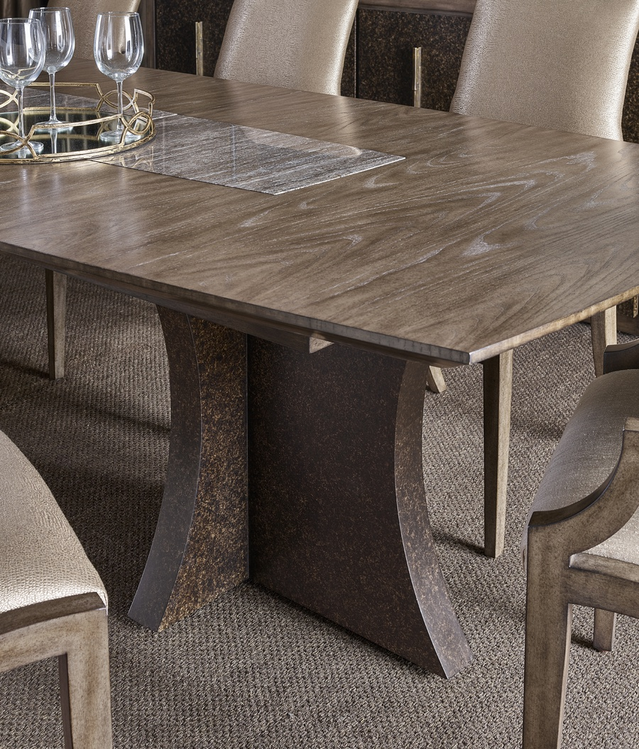 Eclipse Dining Table shown with:Agate finish on the basePumice finish on the topTop inset of Polished Titanium Travertine MarbleShown with leaf