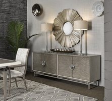 Equinox Credenza shown with:Slate finish with Cashmere Silver trimSlate finish on doorsPolished Greystone Marble topStainless Steel metal legsPolished Nickel hardware