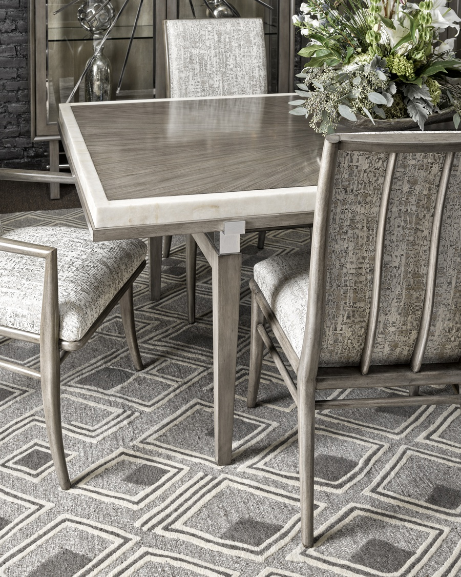 Equinox Dining Table shown with:Bombay finish with Cashmere Silver trimBombay finish on legsStainless Steel metal bracketsAntique Mirror tile inset