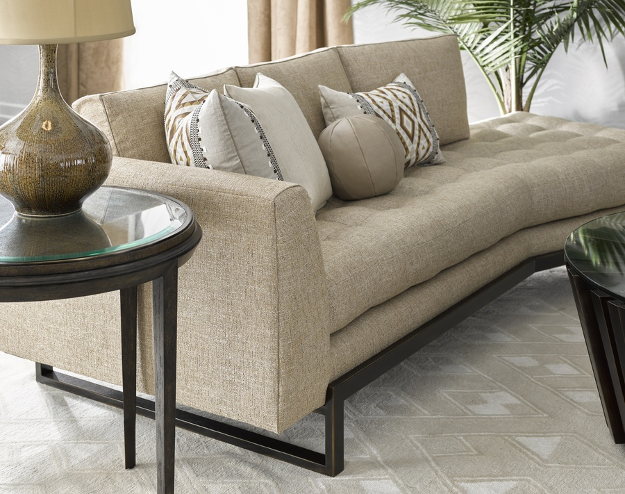 Flynn Sofa shown with: Boxed bench seat with quilted button detailBuilt-to-the-floor with metal base in Bronzed Brass finish