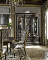 Grand Traditions Display Cabinet shown with:Noche finishHavana contrast interior finishAged Gold Leaf finish trimDecorative hardware in Antique Brass
