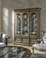 Grand Traditions Display Cabinet shown with:Bronzed Silver finishVerona Silver Leaf finish trimDecorative hardware in Antique NickelAntique Mirror back