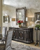 Grand Traditions Credenza shown with:Bombay finishVerona Silver Leaf finish trimDecorative hardware in Antique NickelInset top of Antique Mirror