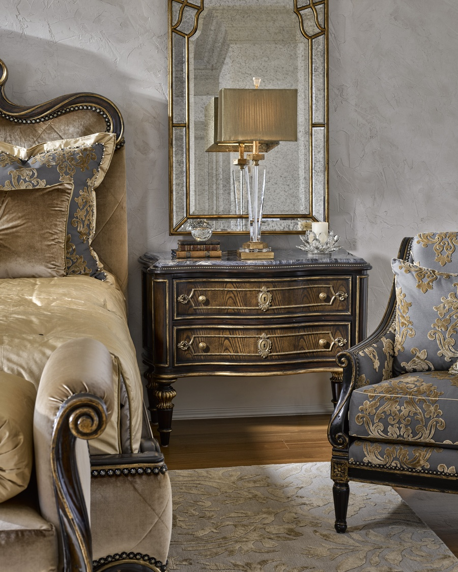 Grand Traditions Nightstand shown with:Bronzed Silver finishVerona Silver leaf finish trimDecorative hardware in Antique NickelPolished Michaelangelo Marble top