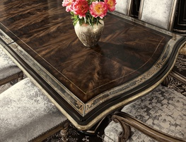 Grand Traditions Dining Table shown with:Bombay finishVerona Silver Leaf finish trimAntique mirror inlay on top