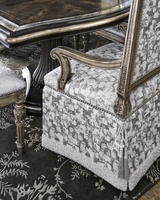 Grand Traditions Arm Chair shown with:Bronzed SilverfinishVerona Silver Leaf finishtrimSilverStar nailhead trimDeep skirt with contrast underskirtTassels