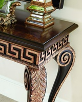 Ionia Console shown with:Noche finishAged Venetian Gold Leaf finish trimHavana finish on top