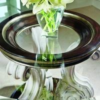 Ionia Round Dining Tableshown with:BombayfinishVersaillesLeaf finish trimStone pedestal