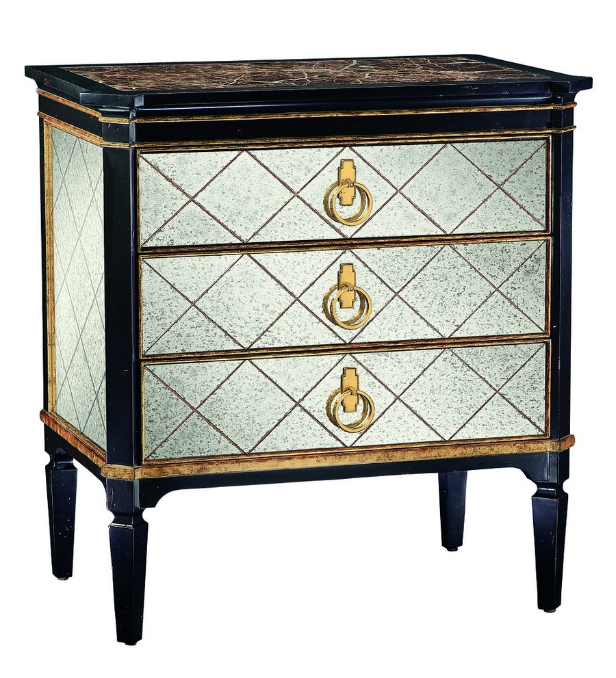 Ionia Nightstand shown with:Noche finishAged Venetian Gold Leaf finish trimRegency Glass panel insetsPolished Madeira Marble topPolished Brass hardware