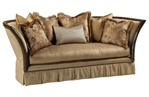 Iris Sofa shown with: Boxed bench seat Box pleated deepskirt with dressmaker back and sideswith decorative buttonsOld World Sumatra finishAged Gold Leaf finish trimAntique Brass nailhead frame trim