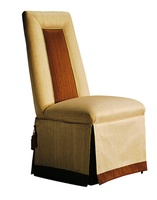 """Justina Side Chair shown with:Tight seat and backDeep skirt with split back and button detailContrast inset back panelContrast underskirt and2½"""" band at bottom of skirtCastersAccessory tassel ties"""