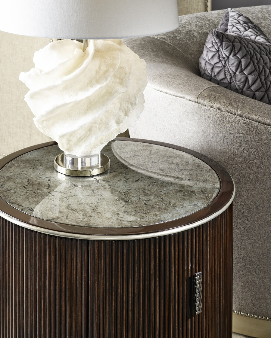 Maison End Table shown with: Riviera finish Cashmere Silver finish on plinth baseCashmere Silver finish trim Platinum Eglomise Mirror topAntique Nickelhardware