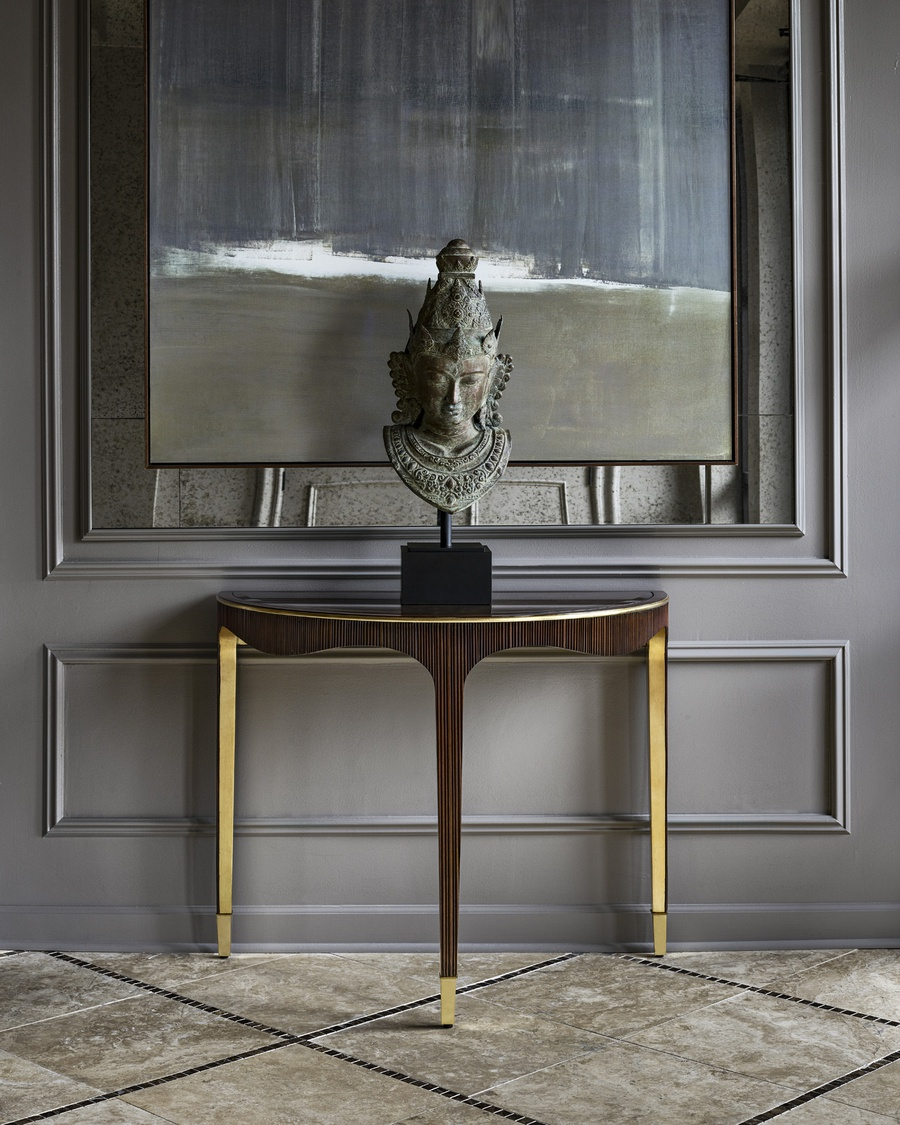 Maison Console shown with:Ebony finishEbony finish on inside legDeco Silver finish trim Platinum Eglomise Mirror top Polished Nickel ferrules