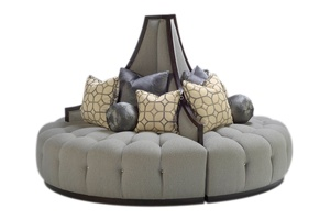 Mirage RoundSofa shown with: Button tufted seatBuilt-to-the-floor with plinth base in Sumatra finishMerengue nailhead frame trim