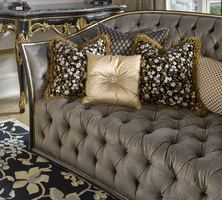 Mila Sofa shown with:Button tuftedseat and backBuilt-to-the-floorfront withbuilt-in skirt on back and sidesand decorative button detailBombayfinishVenetian Gold Leaf finish trimBronze Star nailhead frame trim across front andon outside back and arms