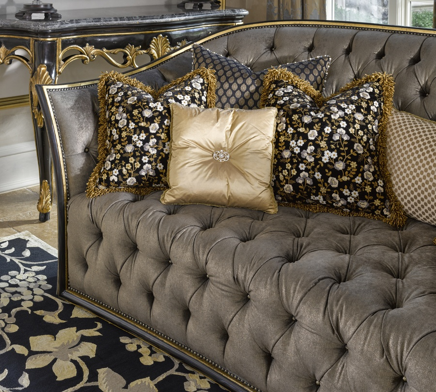 Mila Sofa shown with:Button tuftedseat and backBuilt-to-the-floorfront withbuilt-in skirt on back and sidesand decorative button detailOrleans finishVersailles Leaf finish trimBraid frame trim around frontBronze Star nailhead frame trim on outside back and arms
