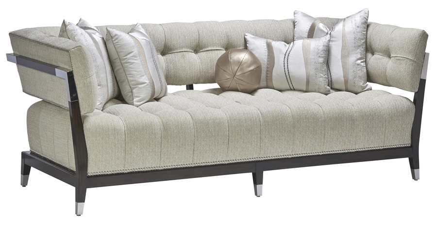 MontrealSofa shown with:Button tuftedseatExposed wood legs and frame in Bombayfinish withStainless Steel ferrules and bracketsSilver nailhead frame trim