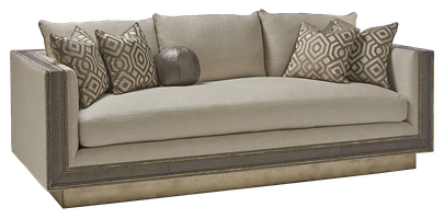 Nebula Sofa shown with:Boxed bench seatBuilt-to-the-floorwood frame in Versaillesleaf finish withLeatherpanel insetSilver Starnailhead frame trim
