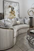 Odessa Sofa shown with:Boxed benchBuilt-to-the-floor baseBombay finish with Silver Cloud trimMerengue nailhead frame trim