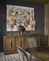 Palms Credenza shown with:Saddle finish withSatin Brass accentsPolished Brown Travertine Marble topSatin Brass hardware