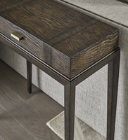 Palms Chairside Table shown with:Saddle finish on topDark Bay finish on baseRaffia Accents in Dark Bay finishDecorative hardware in Satin Brass finish