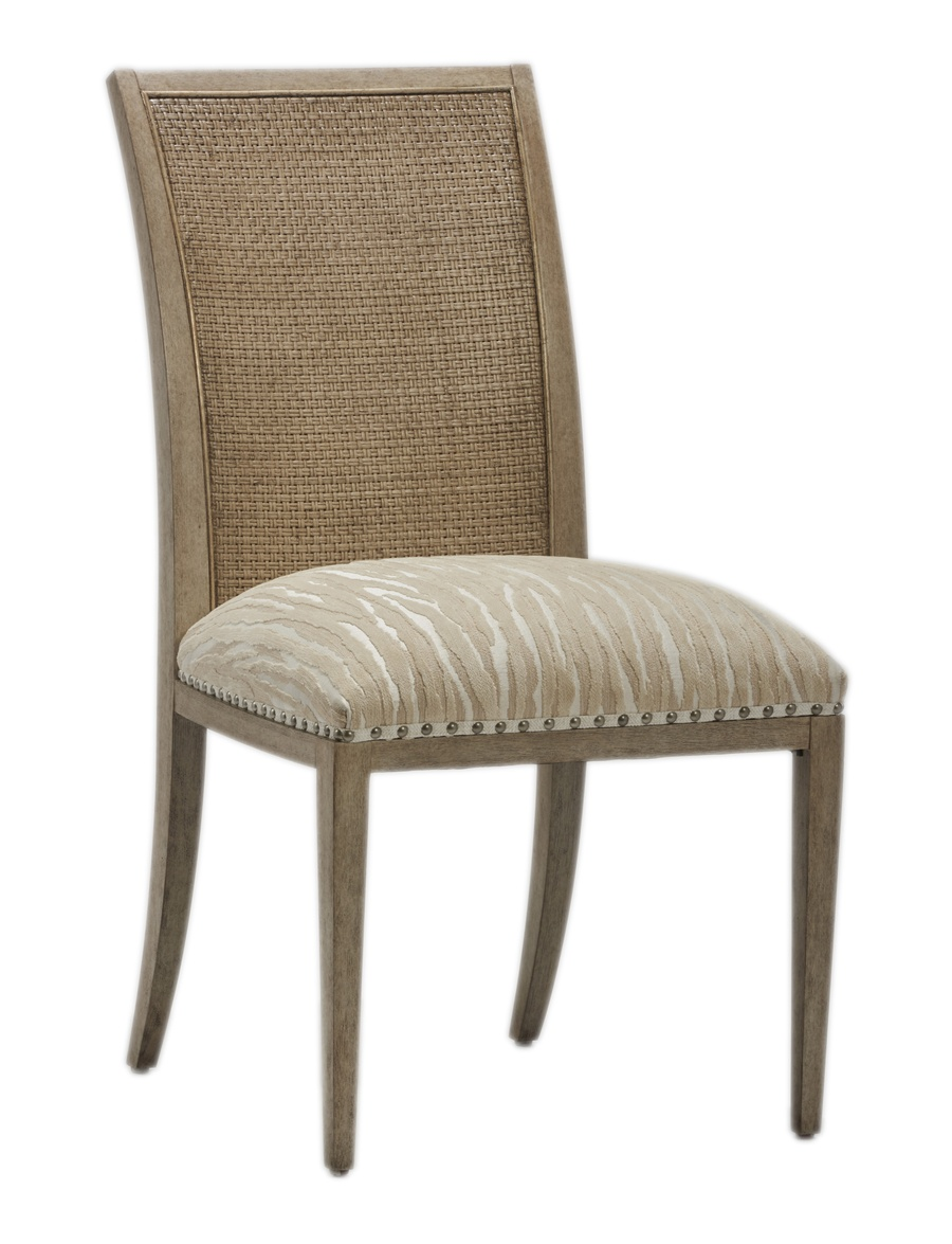 Palms Side Chair shown with:Tight SeatFrame and Raffia back in Dapple finish withSilver Cloud Leaf finish trimSpaced Pewter nailhead frame trim over tape