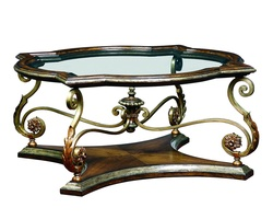 Seville Cocktail Table shown with:Heirloom Brentwoodfinishwith metal leaf finish trimDecorative metalwork in Antique Medici withAged Gold Leaf finish trim Inset clear glasstop with beveled edge Available in a selection of finishes and finish trims