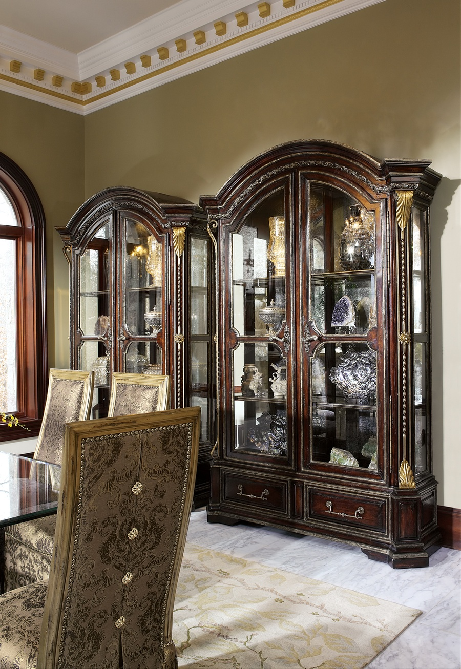 Seville Display Cabinet shown with:Old World Vintage Noir finishAged Gold Leaf finish trimContrast interior in Heirloom Brentwood finishDecorative metalwork in Antique Gold finishAntique Brass hardware