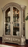 Seville Display Cabinet shown with:Signaturefinish with Metal Leaf finish trimContrast interior in Heirloom Brentwood finishDecorative metalwork in Aged Metal finishMedici Nickelhardware Available in a selection of finishes and finish trims