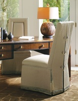 "Justina Side Chair shown with:Tight seat and backMerengue nailhead frame trimDeep skirt with split back and button detailContrast 2½"" band and decorative tape at bottom of skirtCastersAccessory tassel ties"