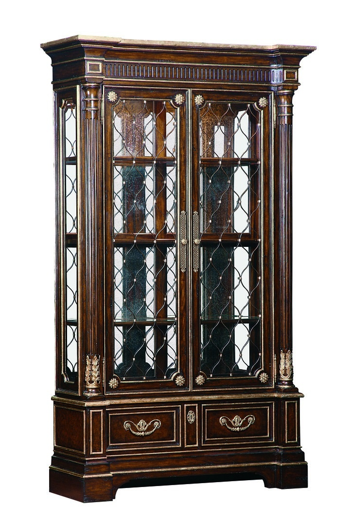 Trianon Court Display Cabinet shown with:Old World Havana finishAged Gold Leaf finish trimDecorative metalwork in Aged Metal finish with Aged Gold Leaf finish trimAntique Brass hardware