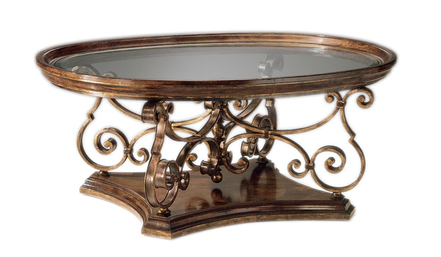 Verona Cocktail Table shown with:Old World Hazelnut finishAged Gold Leaf finish trimDecorative metalwork in Aged Metal finish withAged Gold Leaf finish trim Inset clear glass top with beveled edge