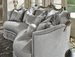 Versailles Sofa shown with:Boxed bench seatDeep skirt with built-in sides and back and decorative button detailTape trim at bottom edge of skirtBronzed Silver finish with Verona Silver leaf finish trimSilver Star nailhead frame trim