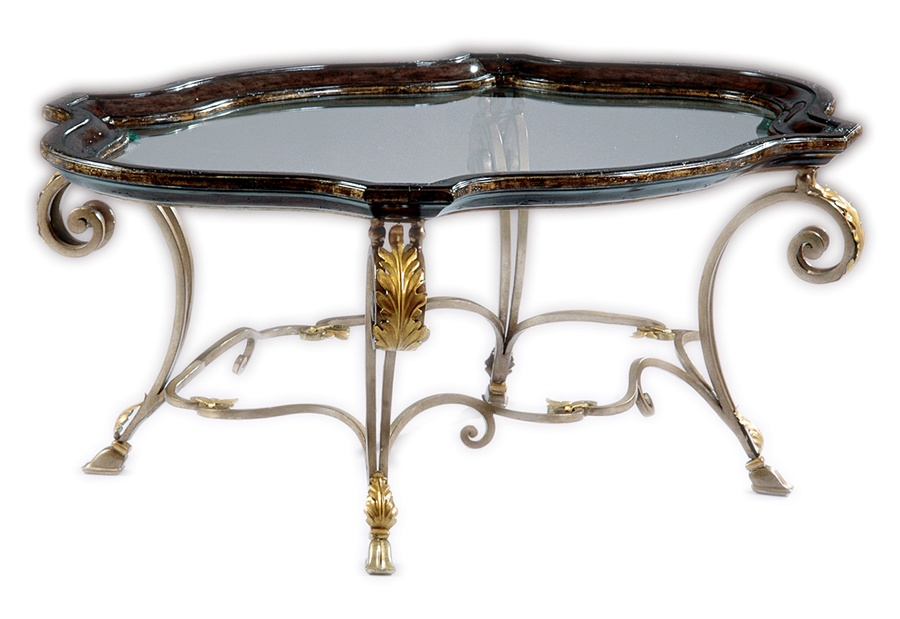 VouvrayCocktail Table shown with:Antique Medicifinish withAged Gold Leaf trim on baseOld World Vintage Noirfinish withAged Gold Leaf trim ontop frame Inset clear glasstop with beveled edge