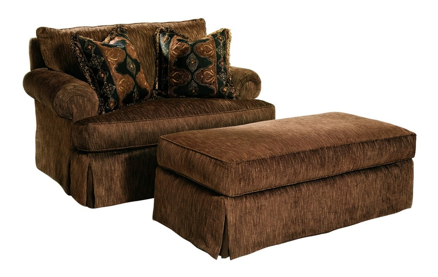 Santa Barbara Ottoman shown with:Semi-attached boxed cushionTraditional legs in Sumatra finishSilver nailhead frame trim